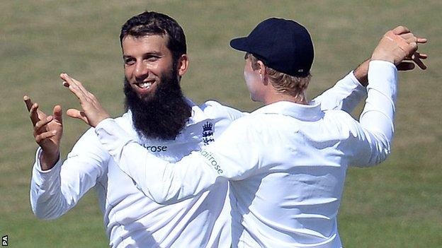England's Moeen Ali celebrates a wicket