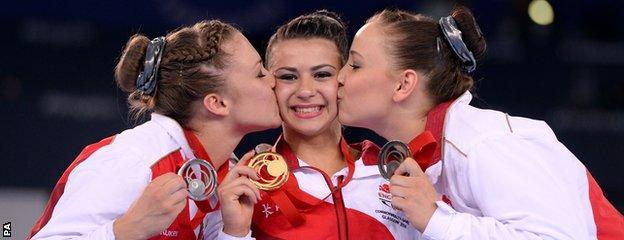 England's Claudia Fragapane (centre) is kissed by compatriots Ruby Harrold (left) and Hannah Whelan (right).