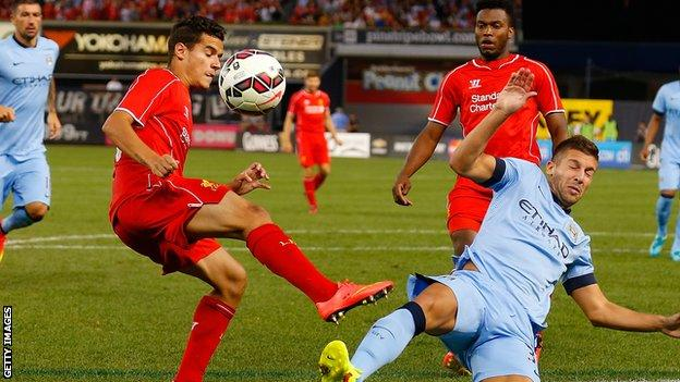 Matija Nastasic of Manchester City (right) and Philippe Coutinho of Liverpool vie for the ball during the International Champions Cup tie at Yankee Stadium