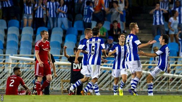 Real Sociedad's David Zurutuza (2nd right) celebrates after putting his side ahead.
