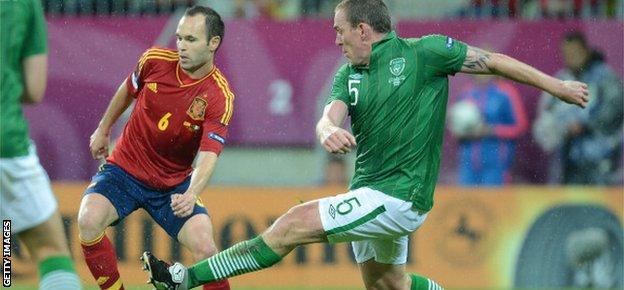 Richard Dunne and Andres Iniesta