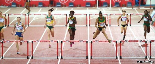 Kaliese Spencer of Jamaica (3R) clears the final hurdle ahead of Eilidh Child of Scotland (2L)