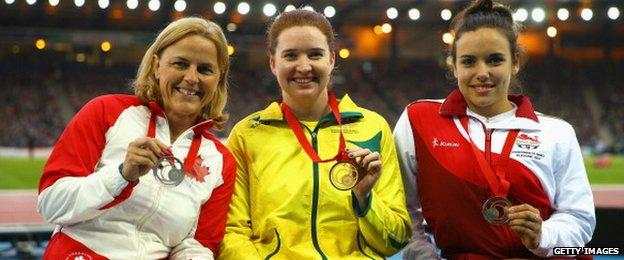 Silver medallist Diane Roy of Canada, gold medallist Angela Ballard of Australia and bronze medallist Jade Jones of England pose on the podium during the medal ceremony for the Women's Para-Sport 1500 metres T54