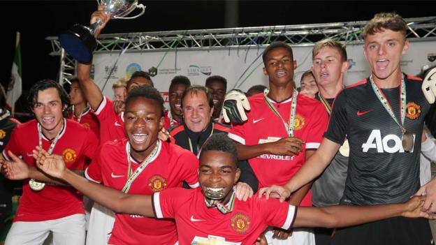 Manchester United celebrate after beating French team Vendee 1-0 in the final of the Premier Section at the 2014 Milk Cup