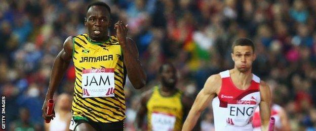 Usain Bolt of Jamaica holds off England's Danny Talbot
