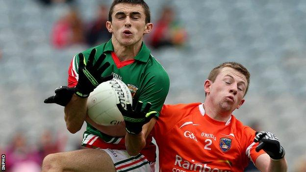 Mayo's Cian Healy battles with Armagh's Fergus Quinn