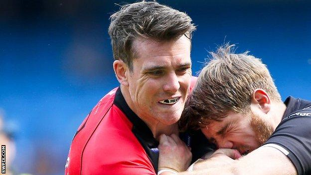 Matty Ashurst tackles Widnes's Paul Johnson