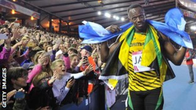 Usain Bolt celebrates at the Commonwealth Games