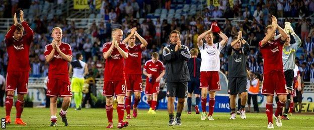 Aberdeen players applaud their fans in San Sebastien