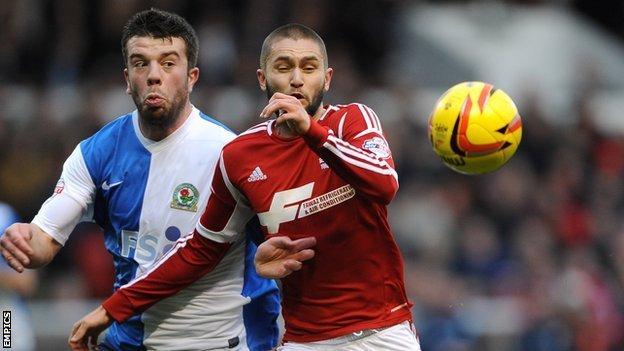 Nottingham Forest's Henri Lansbury (right) battles for possession with Grant Hanley of Blackburn Rovers