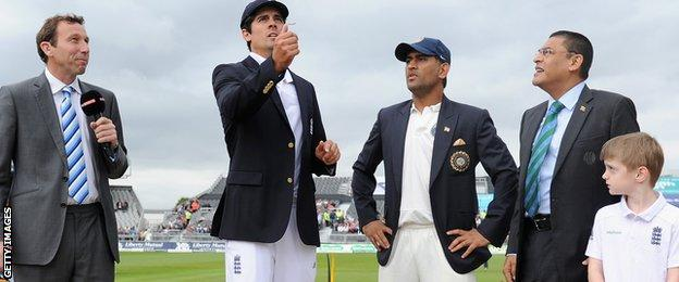 England captain Alastair Cook and India skipper Mahendra Dhoni at the toss