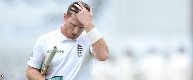England's Ian Bell walks off