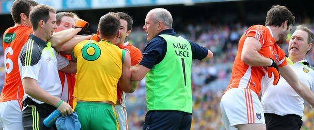 A scuffle breaks out between Armagh and Donegal players and officials during the All-Ireland quarter-final