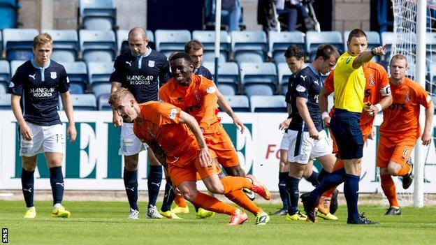Kilmarnock players celebrate after Craig Slater scores against Dundee