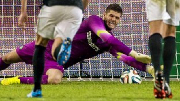 Fraser Forster saves a penalty for Celtic against Legia Warsaw