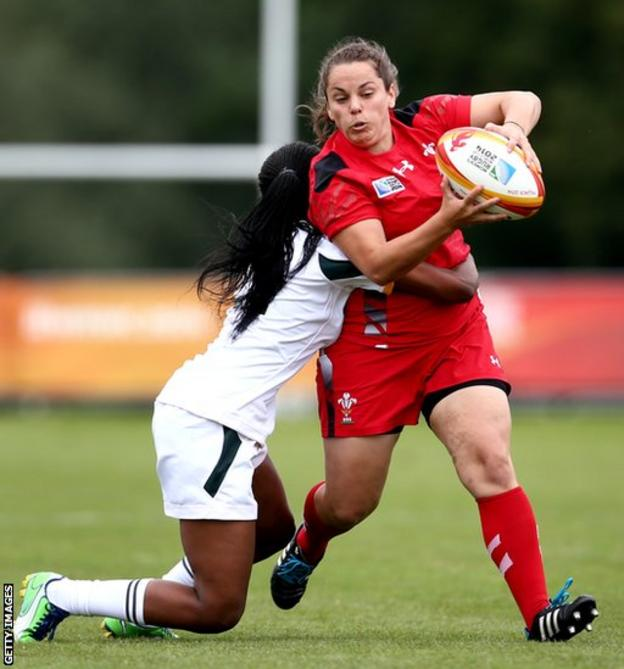 Lowri Harries is tackled by Sinazo Nobele of South Africa