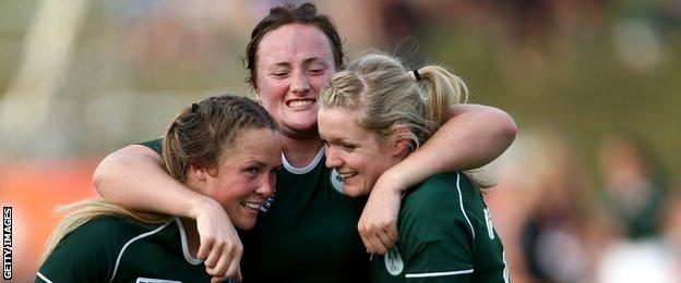 Ashleigh Baxter, Ailis Egan and Vikki McGinn of Ireland embrace after their win over New Zealand