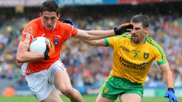 Rory Grugan of Armagh in possession against Donegal's Paddy McGrath during a closely-contested All-Ireland quarter-final at Croke Park