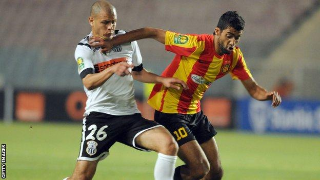 Esperance's Oussama Darragi challenges Setif's Mohamed Lagraa