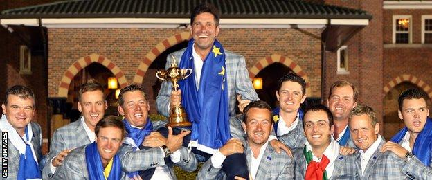 The European Ryder Cup team hold aloft their winning captain Jose Maria Olazabal.