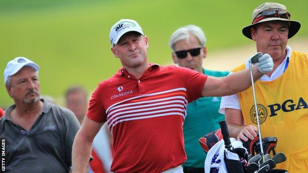 Jamie Donaldson of Wales prepares to hit an approach shot