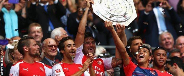 Arsenal players celebrate winning the Community Shield
