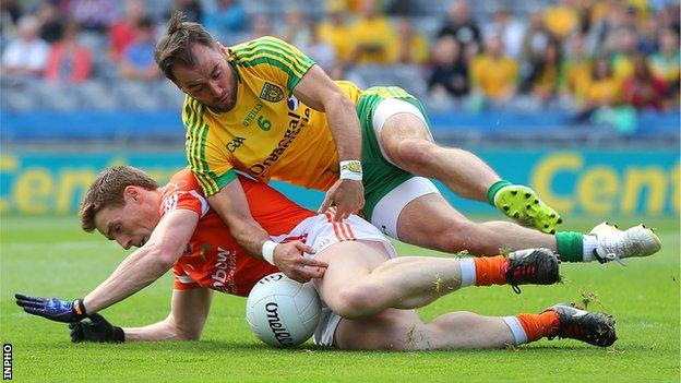 Karl Lacey battles with Armagh's Charlie Vernon in Saturday's All-Ireland quarter-final