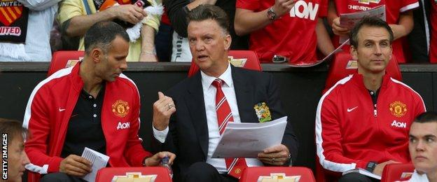 Manchester United manager Louis van Gaal (centre), assistant Ryan Giggs (left) and assistant Albert Stuivenberg (right)