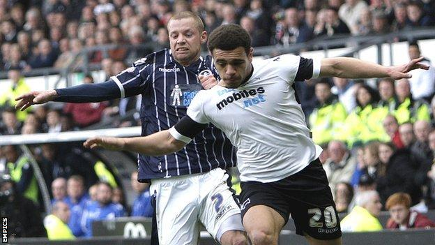 Derby County's Mason Bennett outmuscles Alan Dunne (left) of Millwall