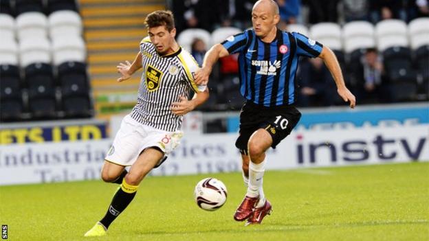 St Mirren midfielder Kenny McLean bursts past Hamilton Accies player-manager Alex Neil
