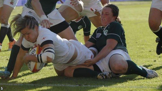 England's Marlie Packer scores a try while Ireland's Gillian Bourke tries to stop her