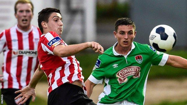 Derry's Shaun Kelly and Cork forward Josh O'Shea battle for possession