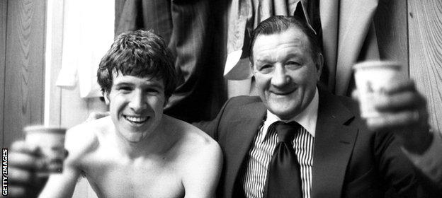 Liverpool's Emlyn Hughes relaxes with Bob Paisley after beating Everton 3-0 in the FA Cup semi-final
