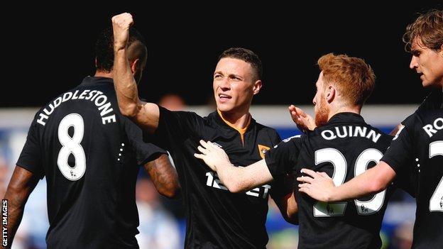 James Chester celebrates scoring Hull's goal at Loftus Road