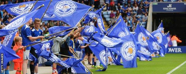 Leicester City fans welcome their team