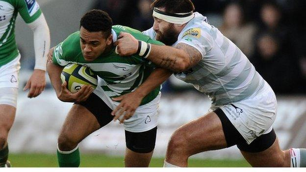 Zach Kibirige is tackled by Matt Parr of London Irish during the LV= Cup match between Newcastle Falcons and London Irish at Kingston Park