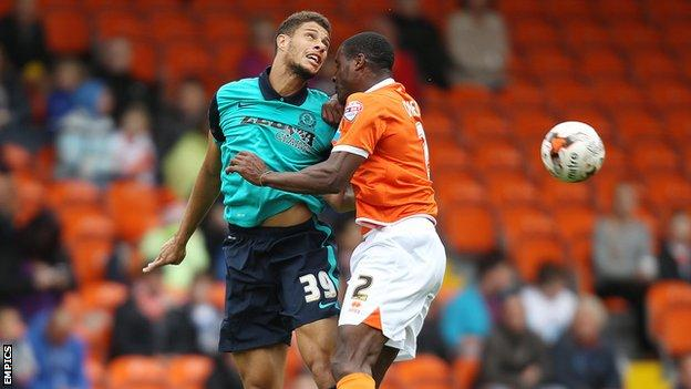 Rudy Gestede and Donervon Daniels jump for a header