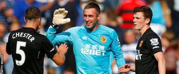 James Chester (right) celebrates with Allan McGregor (centre)