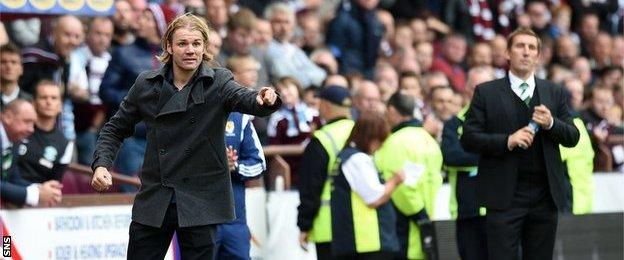 Hearts head coach Robbie Neilson guides his team at Tynecastle as Hibs manager Alan Stubbs looks on