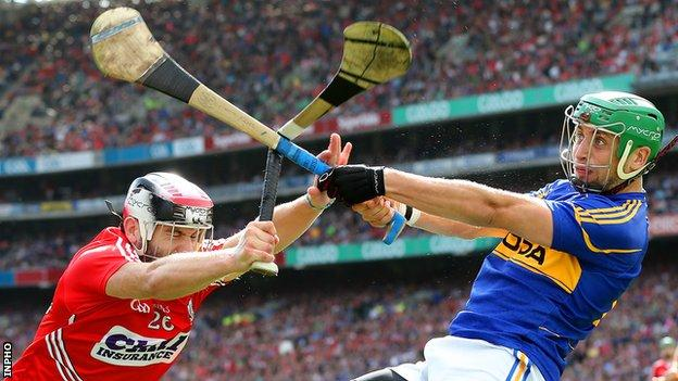 Cork's Paudie O'Sullivan and Tipperary's James Barry