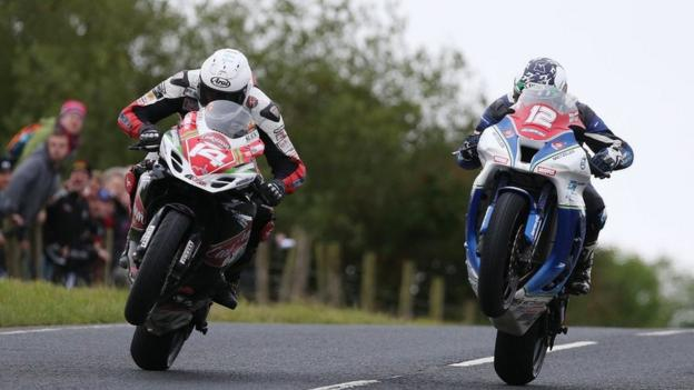 Manxman Dan Kneen edged out Dean Harrison by one thousandth of a second to win the Superstock race
