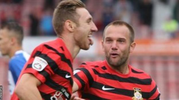 Louis Moult celebrates with Neil Ashton