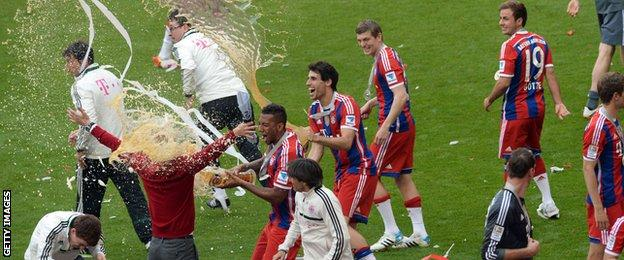 Bayern players soak Pep Guardiola with beer