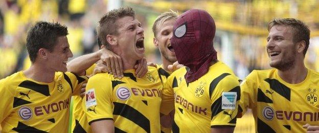 Pierre-Emerick Aubameyang celebrates a goal in a Spiderman mask