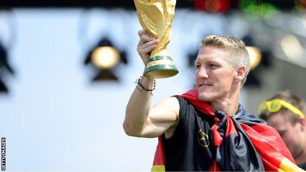 Bastian Schweinsteiger holds aloft the 2014 World Cup