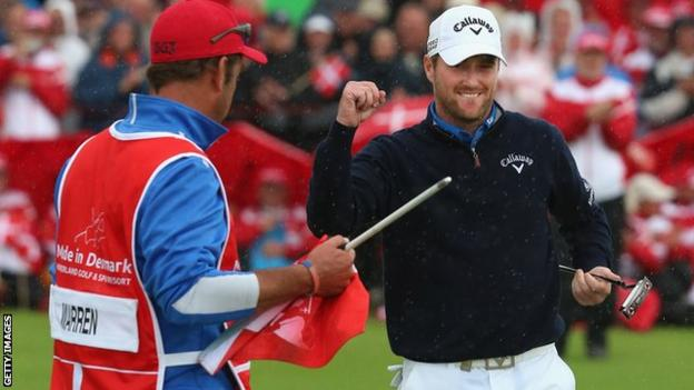 Marc Warren holed a brilliant birdie putt on the 14th green to help secure the title.