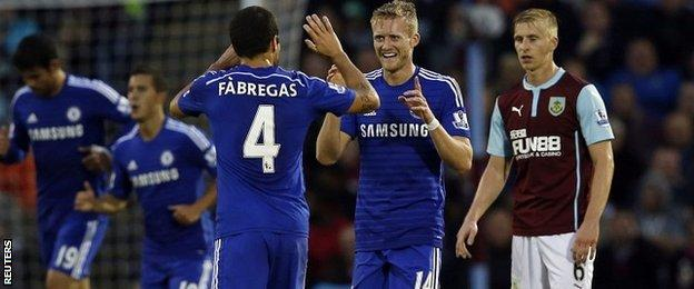 Cesc Fabregas and Andre Schurrle celebrate