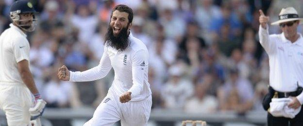 """England""""s Moeen Ali (C) celebrates after dismissing India""""s Cheteshwar Pujara (not pictured) during the fourth cricket test match at Old Trafford cricket ground in Manchester, England August 9, 2014."""