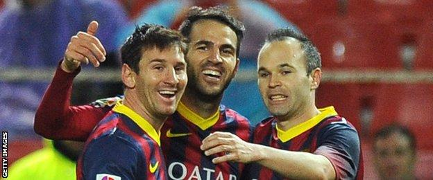 Cesc Fabregas, centre, with former Barcelona team-mates Lionel Messi (left) and Andres Iniesta