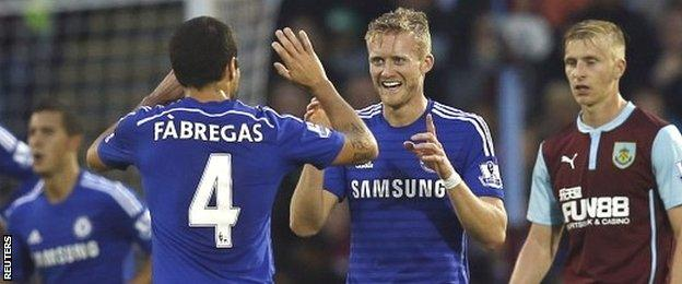 Cesc Fabregas celebrates Chelsea's second goal against Burnley with scorer Andre Schurrle
